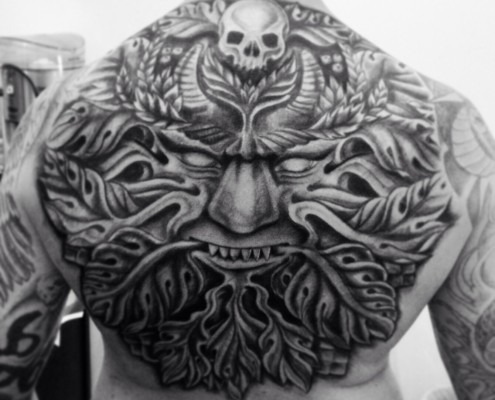 Green man back tattoo.